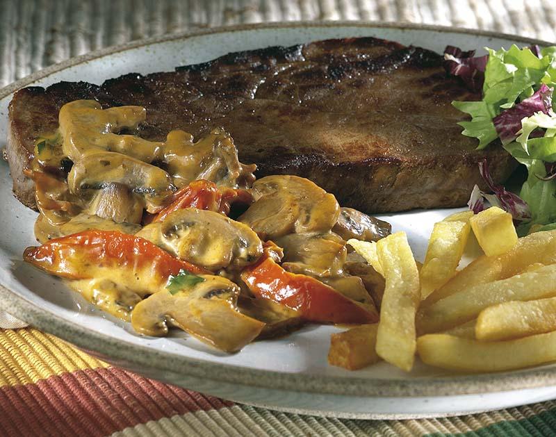Biefstuk met gedroogde tomaatjes en champignons